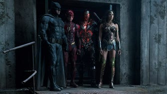 Batman (far left, Ben Affleck), the Flash (Ezra Miller), Cyborg (Ray Fisher) and Wonder Woman (Gal Gadot) in a scene from 'Justice League.'