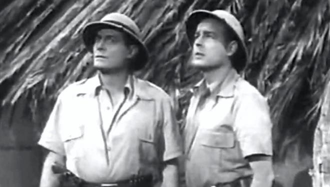 """Jon Hall as Ramar and his assistant played by Ray Montgomery in """"Ramar of the Jungle"""" a nationally syndicated television series in the 1950s."""