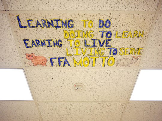 The Future Farmers of America motto is displayed on the ceiling of the FFA classroom at Cascade High School on Thursday, January 22, 2015, in Turner.