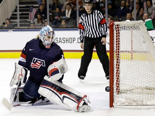 FILE - In this Dec. 15, 2017, file photo, United States goalie Alex Rigsby watches as a shot hits the post during the first period of a women's hockey game against Canada  in San Jose, Calif. U.S. goaltenders Maddie Rooney, Nicole Hensley and Alex Rigsby are all Olympic rookies.  (AP Photo/Marcio Jose Sanchez, File)