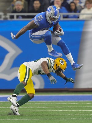 Lions' Eric Ebron hurdles Packers' Jermaine Whitehead during a game Dec. 31, 2017 at Ford Field.