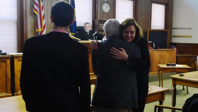Leonard Higgins hugs his attorney, Lauren Regan, after he was sentenced for damage he caused when he shut off an oil pipeline valve in Chouteau County in 2016.