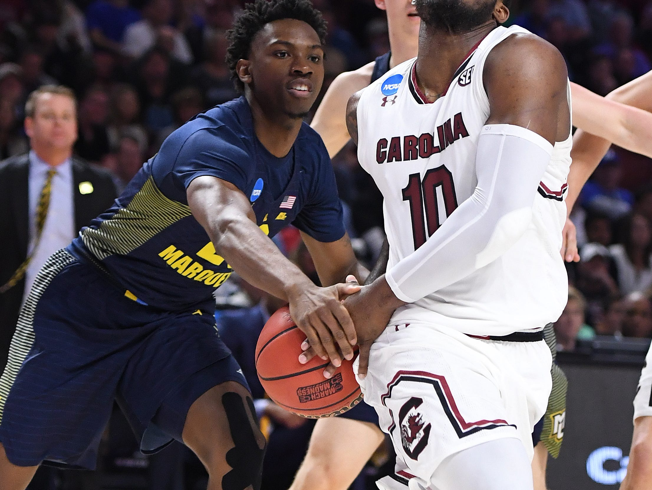 Marquette guard Jajuan Johnson (23) strips the ball from South Carolina guard Sindarius Thornwell (0) during the 1st round of the NCAA Tournament at Bon Secours Wellness Arena in downtown Greenville on Friday, March 17, 2017.