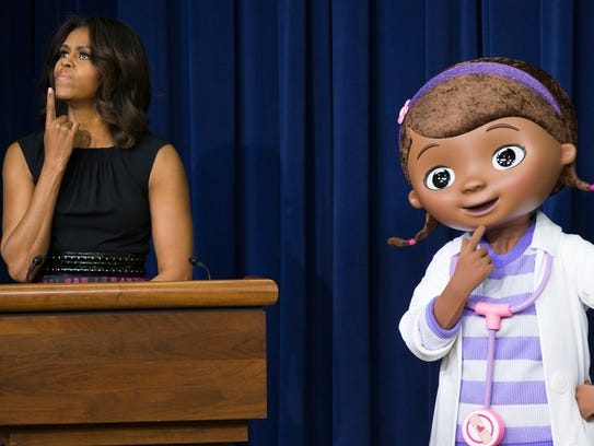 First lady Michelle Obama pauses as she delivers remarks