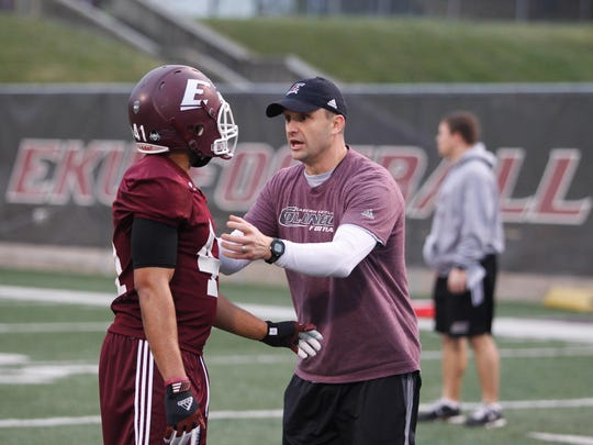 Eastern Kentucky head coach Mark Elder works with a Colonel at practice.