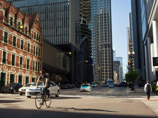 A cyclist crosses Dearborn Street in Chicago.