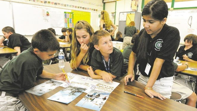 Clayton Middle School sixth-graders work in their classroom.