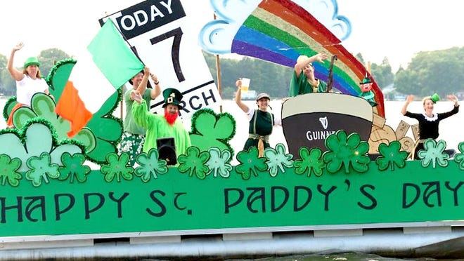"""First place in the 14th annual """"Palmer Lake Flotilla"""" was awarded to  Ryan Doherty and Grant Sahr, with their St. Patrick's Day-themed entry."""