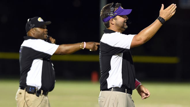 Fort Pierce Central coach Matt Helmerich (right) is stepping down to take a position in Georgia.