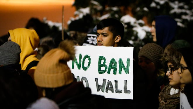 Hundreds gathered at The Rock at MSU Tuesday evening, Jan. 31, 2017, to show their support of refugees, immigrants, and their families impacted by a presidential executive order on immigration.