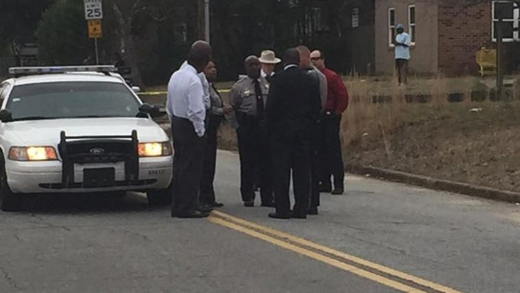 Bibb County deputies at the scene of an officer involved