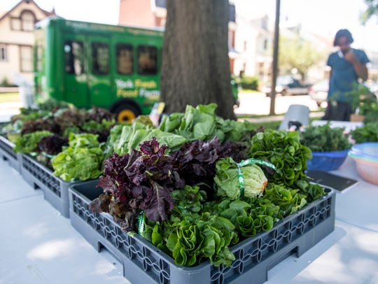 Produce sits on the table on the corner of Pershing