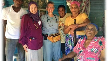 Pictured left to right are: In purple, Yasmin Sharif, M.D., recent graduate of the Family Practice Residency Program at Hunterdon Medical Center, Cindy Barter, M.D. , Faculty of the Family Practice Residency Program at Hunterdon Medical Center  and Family Practice Physician at Hunterdon Family Medicine at Phillips-Barber with patients they treated in the Dominican Republic.