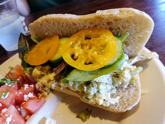 Phoenician spicy chicken salad sandwich with lettuce, tomato, cucumber and watermelon feta salad at Farmboy in Chandler.