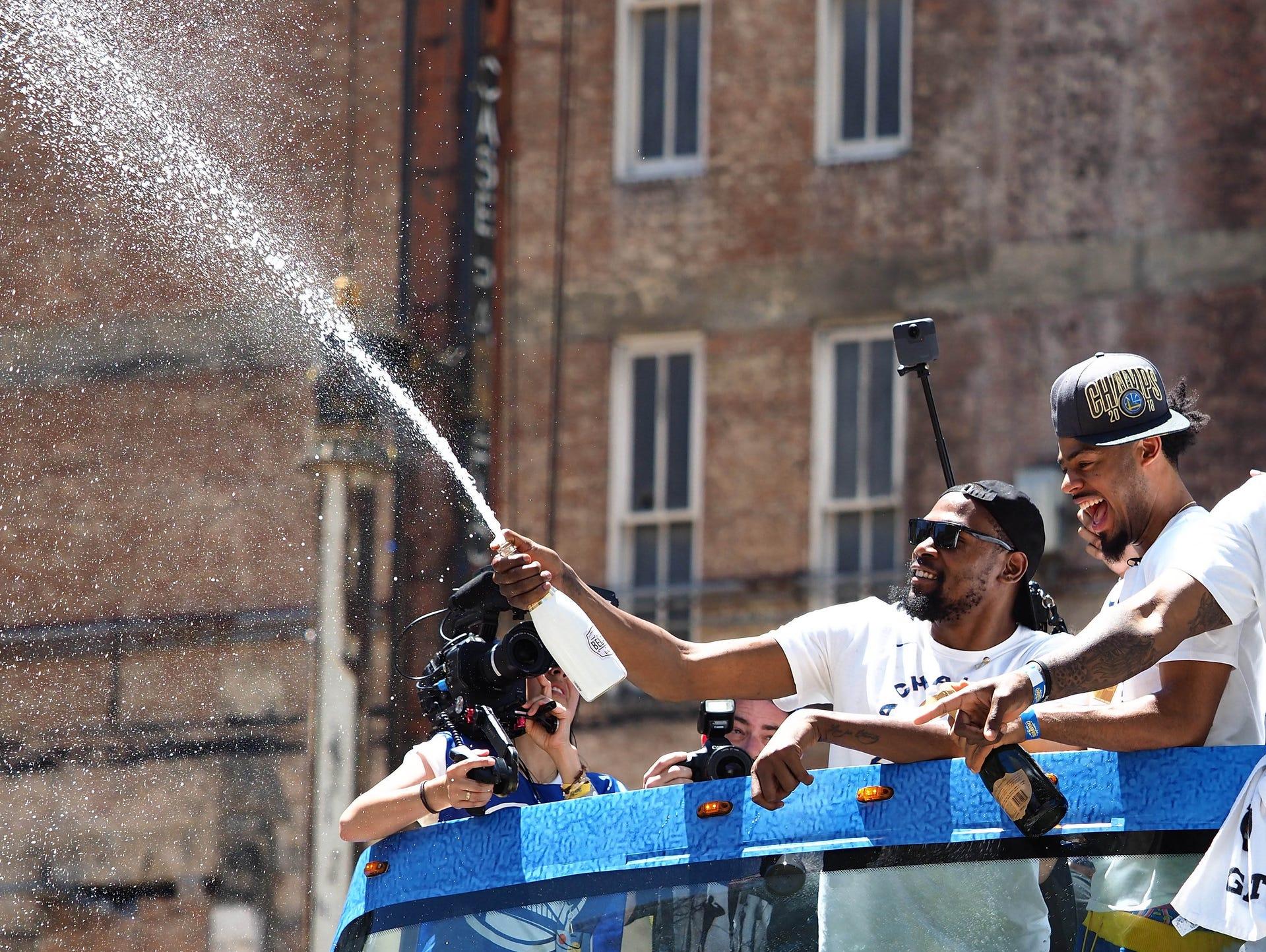 Golden State Warriors forward Kevin Durant (35) sprays