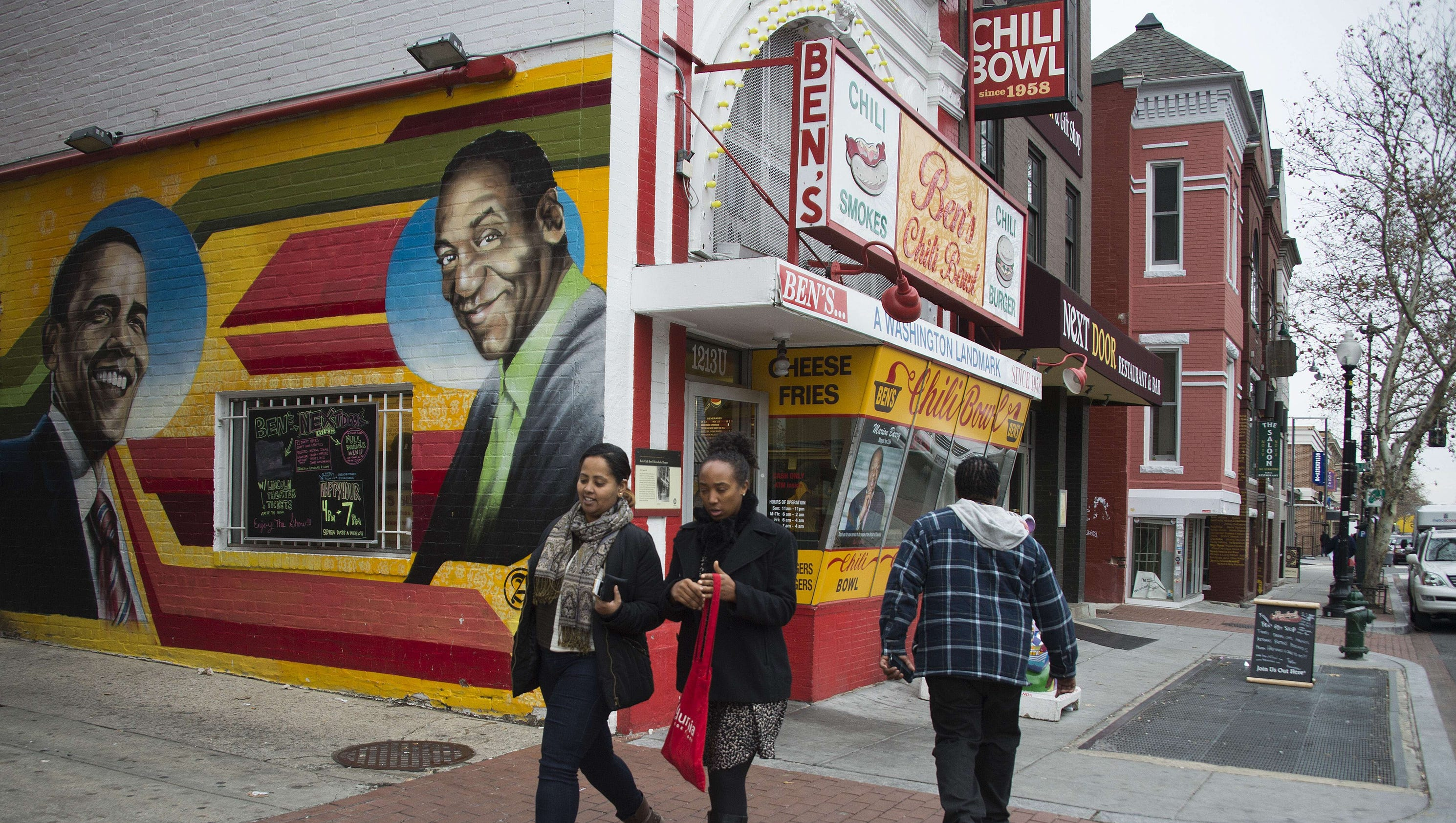 Cosby mural in d c defaced with picture of grinning for America today mural