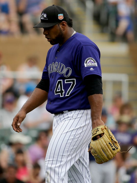 Colorado Rockies relief pitcher Jairo Diaz is taken out of the game after loading the bases during fifth inning of a spring baseball game against the San Diego Padres in Scottsdale, Ariz., Saturday, March 5, 2016. (AP Photo/Chris Carlson)