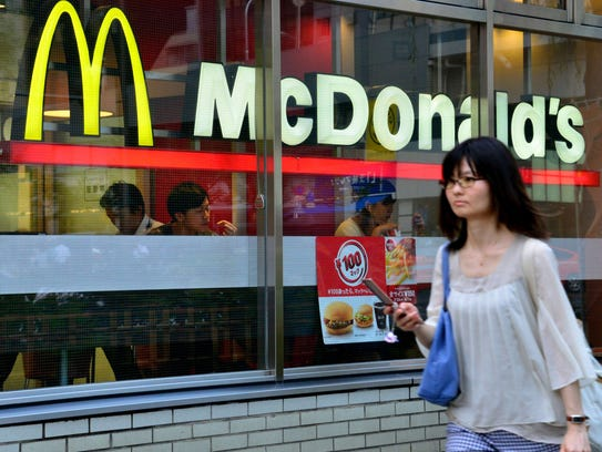Black burger battles: McDonald's Japan unveils dark burger ...
