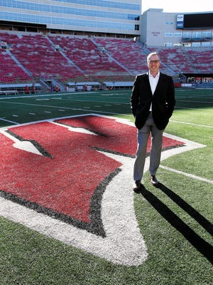 Chris McIntosh, who was an All-American tackle under Barry Alvarez at Wisconsin, was promoted to deputy athletic director at UW on Wednesday.