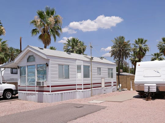 A park home ( no wheels) stands beside RV's at Tempe Travel Trailer Villa where there is an impending eviction of the RV Park's residents to make way for a 423 unit apartment complex along Apache Blvd. as seen in Tempe on June 11, 2015