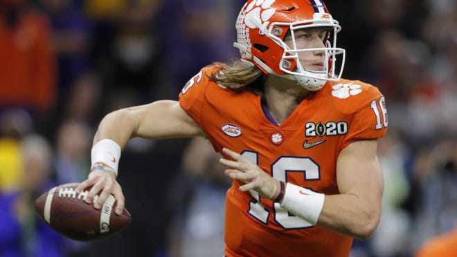 FILE - In this Jan. 13, 2020, file photo, Clemson quarterback Trevor Lawrence looks to pass against LSU during the second half of an NCAA College Football Playoff national championship game in New Orleans. The top-ranked Tigers are 29-1 over the past two seasons and have won five straight ACC championships.