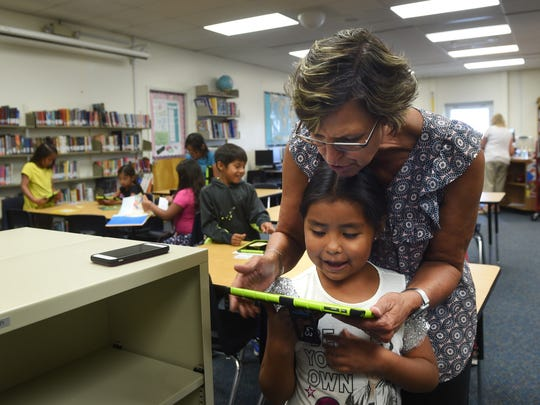Principal Gia Maraccini helps a young student at Natchez Elementary School in Wadsworth on Sept. 6, 2017. Jason Bean/Reno Gazette-Journal- USA TODAY NETWORK