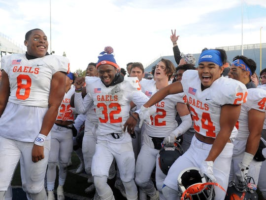 Bishop Gorman players celebrate their 2017 4A state championship win over Reed.