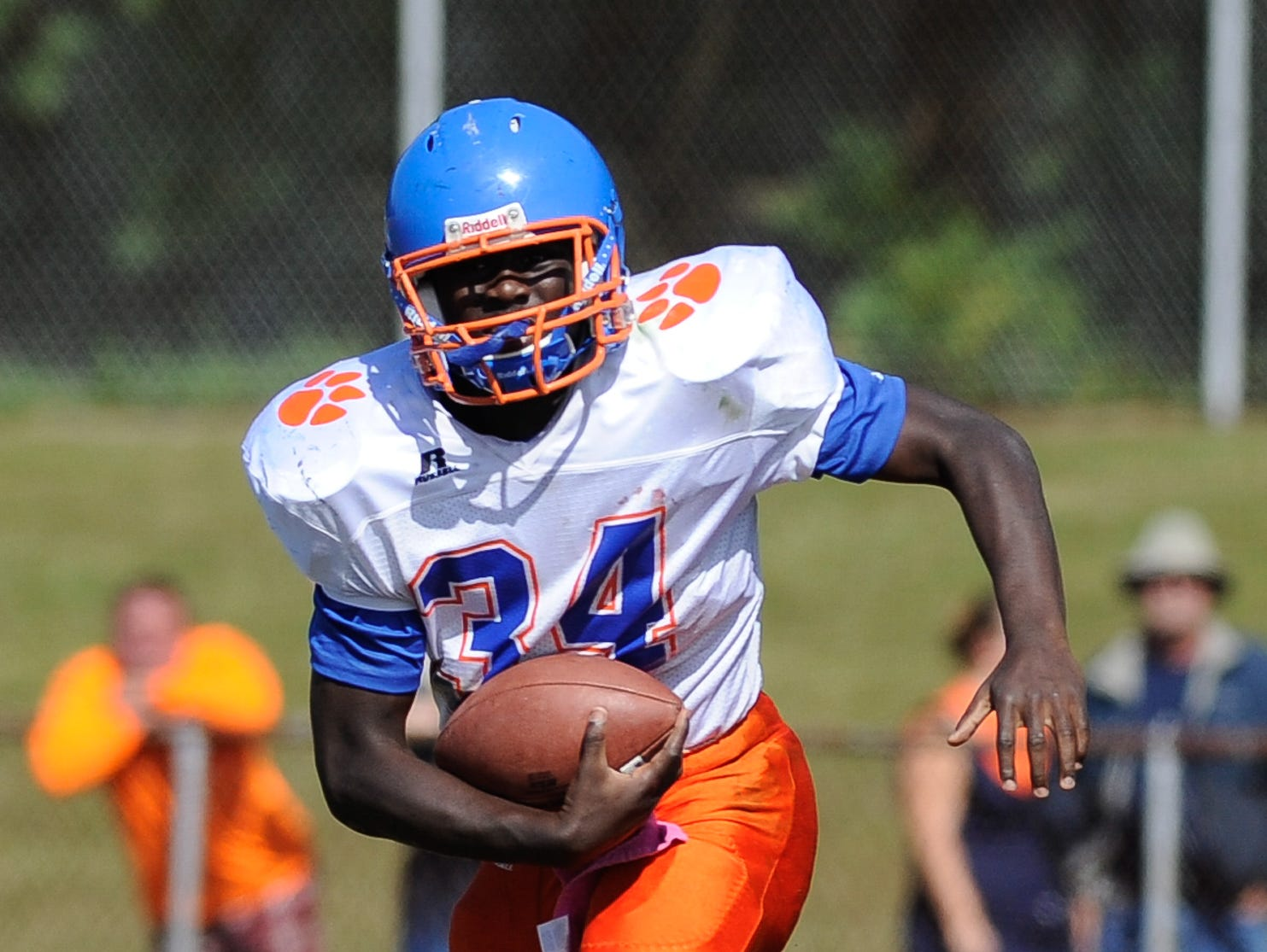 Delmar's #34 Brooks Parker runs the ball in their 19-14 lose against Lake Forest on Saturday at Lake Forest High School.