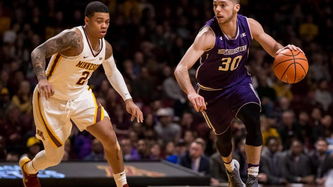 Jan 23, 2018; Minneapolis, MN, USA; Northwestern Wildcats guard Bryant McIntosh (30) dribbles the ball in the first half past Minnesota Gophers guard Nate Mason (2) at Williams Arena. Mandatory Credit: Brad Rempel-USA TODAY Sports