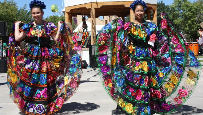 Dancers posed to display their fancy dresses at the Diez y seis de Septiembre fiesta at Mesilla Plaza Saturday.