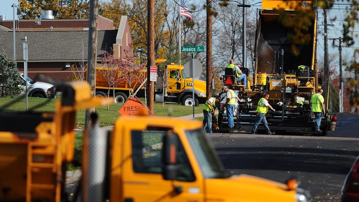Employees with the Department of Public Works do paving Friday at Nye Street and Jessica Avenue east of Drake Springs near Eugene Field Elementary School.