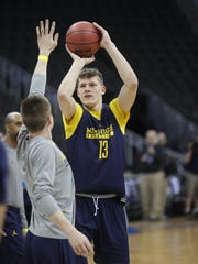 Michigan forward Moe Wagner goes through drills during practice at the NCAA Midwest Regional on Wednesday, March 22, 2017, at the Sprint Center in Kansas City, Mo.