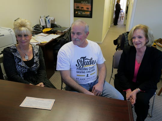 (center) Asbury Park resident Rick Binaco, who recently found his lost gift certificate from co-workers in 2003 for $1,200 to travel anywhere while he was being treated for advanced cancer, talks about the experience with (left) Maria Iadonisi, who collected the money from co-workers and bought the gift certificate for Binaco, and (right) Carol Crothers, president of Sunrise Travel Center, who honored the expired gift certificate,