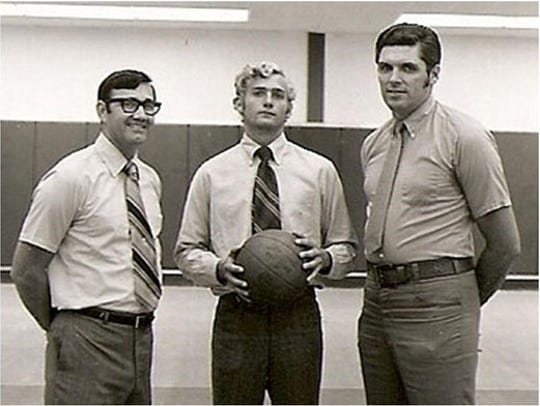 Marvin Beck Sr., left, in this photo as UWF basketball coach with signee Dickie Appleyard (center), now president of Appleyard Agency. Dick Appleyard, a 1969 PHS grad transferred to UWF from Alabama and was part of the Argos early seasons under Beck, who was UWf's first coach 50 years ago when program began.