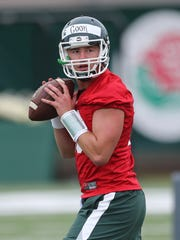 Michigan State quarterback Connor Cook goes through drills during MSU's first practice of the fall Aug. 8, 2015, in East Lansing.