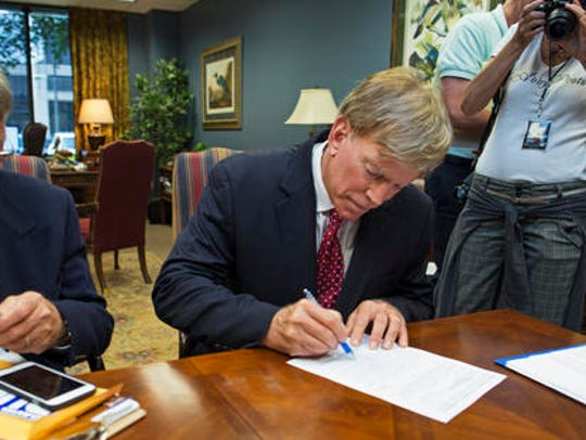 Former Ku Klux Klan leader David Duke registers his