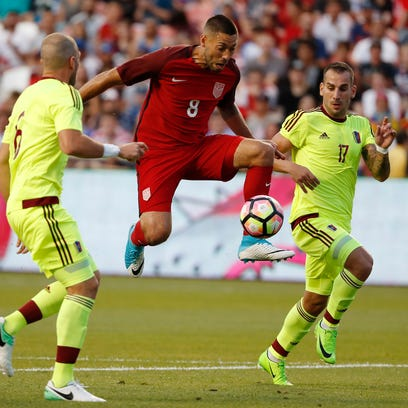 United States forward Clint Dempsey (8) goes for the