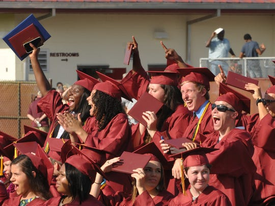 Seniors cheer a classmate on the stage at the 2015