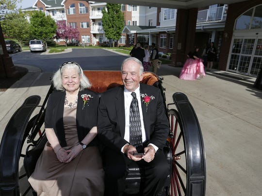 """Walt and Aline Zerrenner enjoy a horse and buggy ride as part of """"Prom Night"""" at Touchmark on West Prospect in Appleton."""
