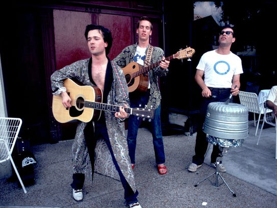 The Violent Femmes busk in Chicago in 1983. Drummer