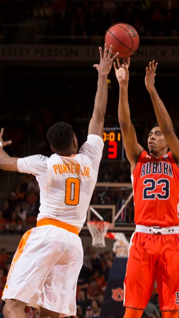 Auburn guard TJ Lang shooting a jump shot over Tennessee guard Kevin Punter in the 83-77 win in the Southeastern Conference.