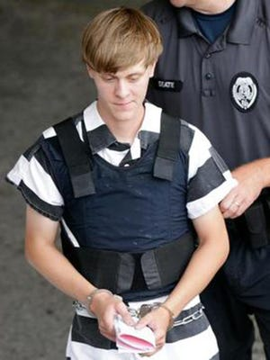 The accused Charleston, S.C., church shooter, Dylann Roof, is escorted June 18, 2015, from the Cleveland County Courthouse in Shelby, N.C.