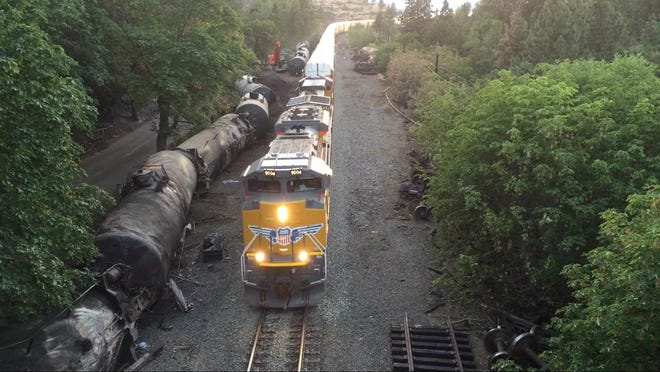 Crumpled oil tankers sit beside the railroad tracks on June 6 after a fiery oil train derailment three days earlier prompted evacuations from the Columbia Gorge town of Mosier.