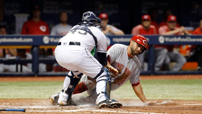 Tampa Bay Rays catcher Jesus Sucre (45) tags out Cincinnati Reds shortstop Jose Peraza (9) at home plate during the fourth inning at Tropicana Field.