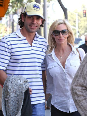 Camille Grammer, seen here last year with boyfriend Dimitri Charalambopoulos, has filed a restraining order against him.
