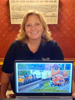 Chi Eastin, General Manager of the Kingsley Inn, shows off the Fort Madison rail cam in operation.