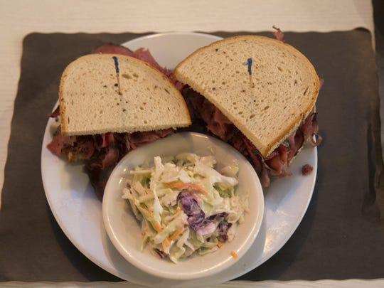 A pastrami sandwich with coleslaw is a signature dish at Shapiro's New York Style Delicatessen in Red Bank. The deli also serves slow-cooked corned beef.