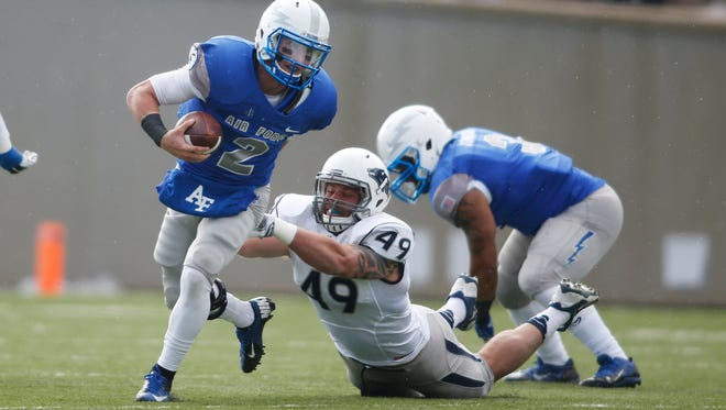Nevada linebacker Jordan Dobrich dives in an attempt to make a tackle against Air Force in 2014.