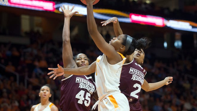 Tennessee's Jordan Reynolds attempts to score while defended by Mississippi State's Chinwe Okorie, left, and Morgan William at Thompson-Boling Arena on Sunday, January 8, 2017. Tennessee lost to Mississippi State, 73-64.