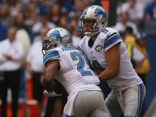 Lions quarterback Matthew Stafford hands the ball off